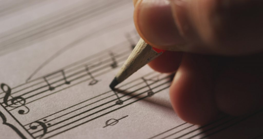 Scoring music for a film on sheet music