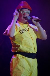 film composer mark mothersbaugh performing on stage as devo