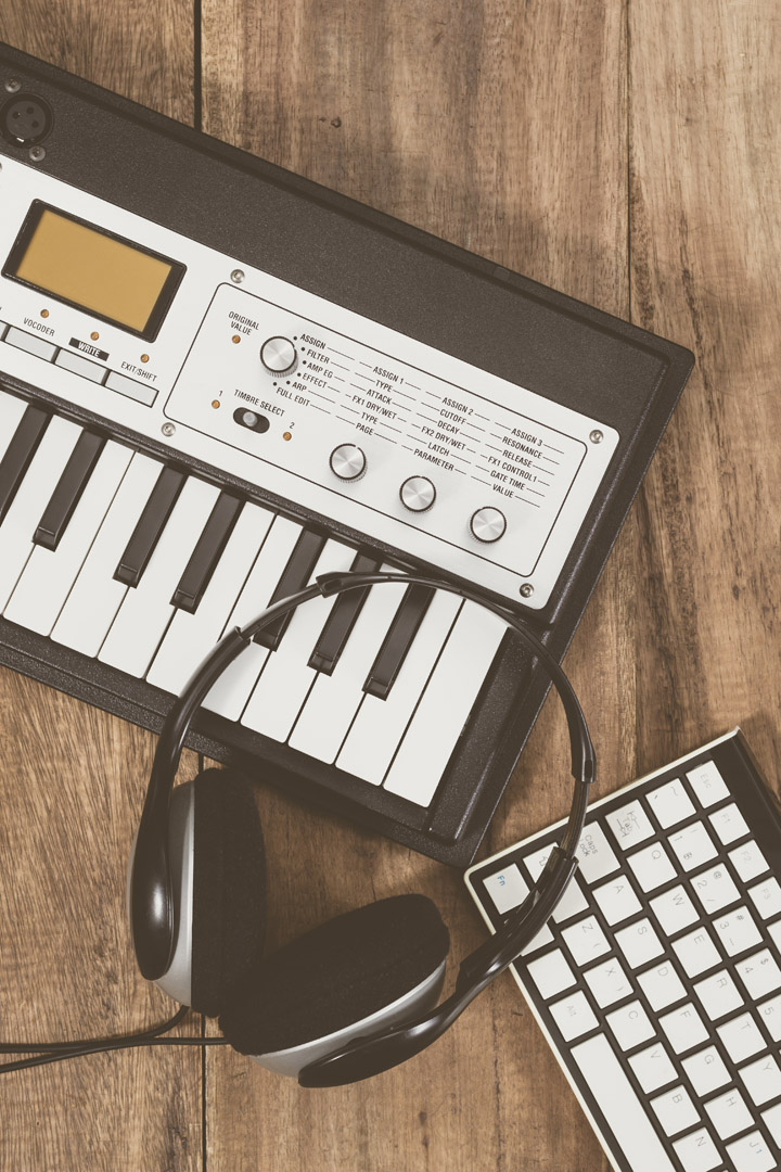 small synth and keyboard with headphones